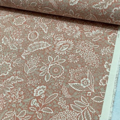 Curtain and upholstery with floral motifs on light pink background