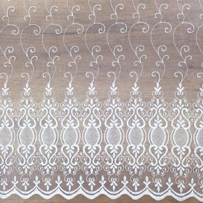 Curtain with embroidery and white ornaments