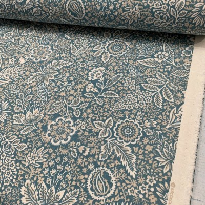 Curtain and upholstery with floral motifs on blue background