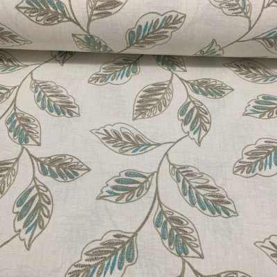 Curtain and upholstery with leaves in grey and blue