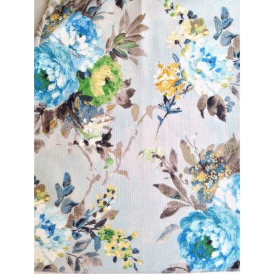 Curtain with abstract flowers in green and blue on light blue background