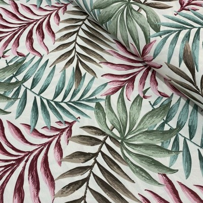 Curtain and upholstery with tropical leaves in pink and green