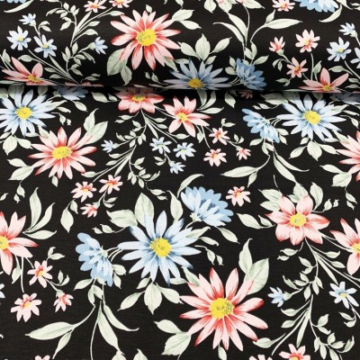 Curtain and upholstery with flowers in pink and blue on black background