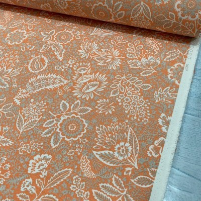 Curtain and upholstery with floral motifs on orange background