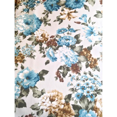 Curtain and upholstery with flowers in blue