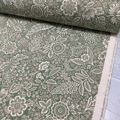 Curtain and upholstery with floral motifs on green background