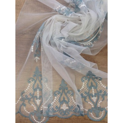 Curtain with embrodery in blue